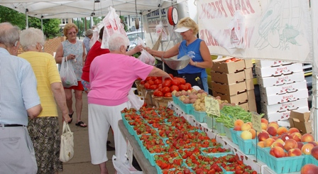 People shopping at the Farmers Market