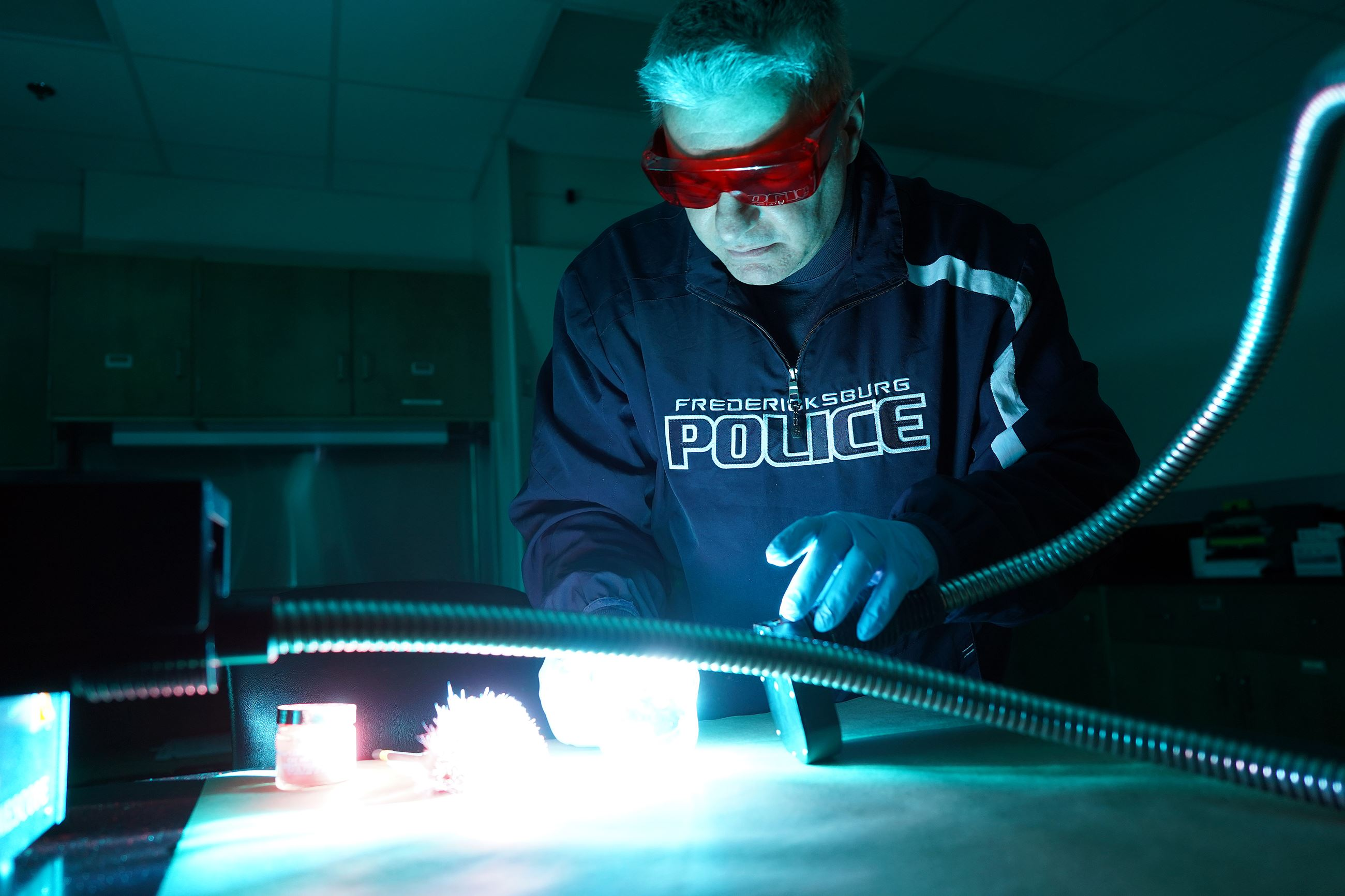 cop doing forensic studies
